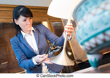 woman working in an antiques store