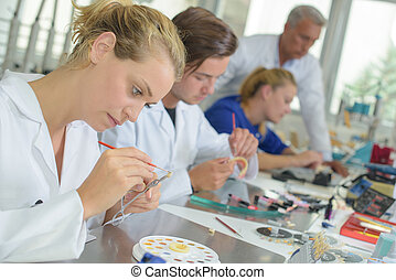Woman working in dental laboratory