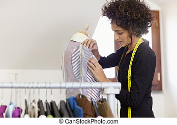 Woman working in fashion design studio - Young hispanic ...