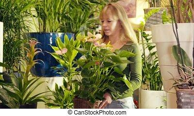 woman working in flower shop arrang