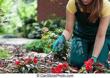 Woman working in garden