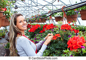 Woman working in nursery.