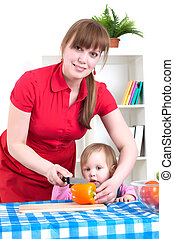 woman working in the kitchen with child