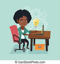 Woman working on a laptop on a new business idea.