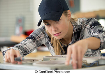 woman working on a new kitchen installation