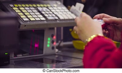 Woman working on cash register in the store - Close up check...