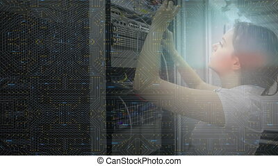 Woman working on computer server while glowing motherboard moves in foreground
