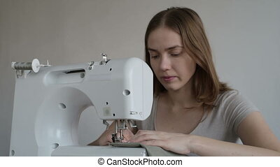 Woman working on the sewing machine