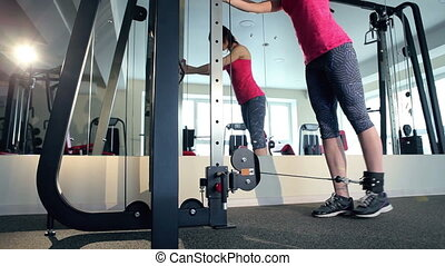 Woman working out at the gym