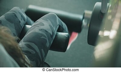 Woman working out lifting weights 4k