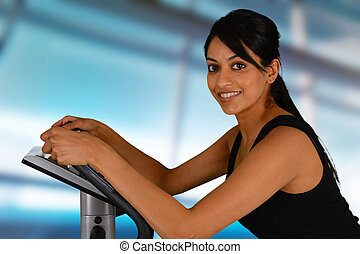 Woman Working Out On Bike