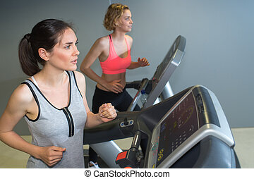 Woman working out on exercise equipment