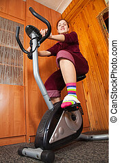 Woman working out on spinning bike