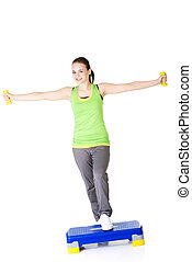 Woman working out on step
