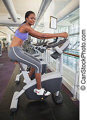 Woman working out on the bike