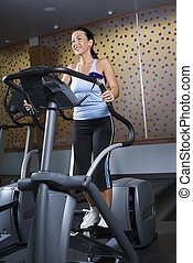 Woman working out. - Prime adult Caucasian female on...