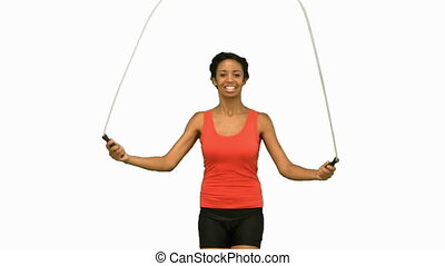 Woman working out with a rope on wh