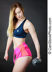 Woman working out with dumbbell