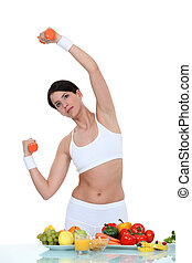Woman working out with dumbbells