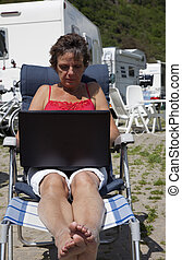 woman working outside on computer