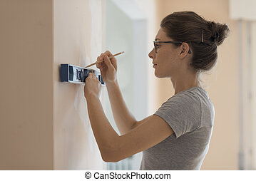 Woman working with a spirit level