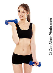Woman working with dumbbells