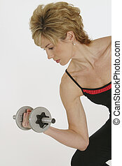 Woman working with dumbells