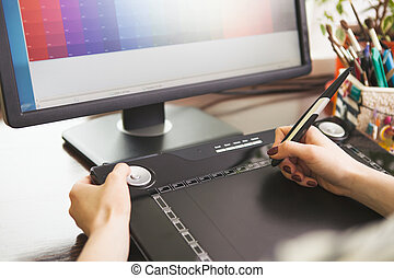 Woman working with graphic tablet