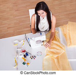 Woman working with her sewing machine