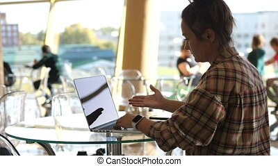 Woman working with laptop on Desktop. Woman Blogger Freelancer Working on Laptop at Cafe made a mistake while working. Close Up Female Hands Using Keypad. Businesswoman Scrolling News Feed Online at Work.