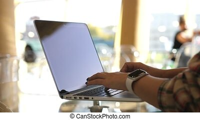 Woman working with laptop on Desktop. Woman Blogger Freelancer Working on Laptop at Cafe. Close Up Female Hands Using Keypad. Businesswoman Scrolling News Feed Online at Work.