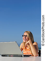 woman working with laptop outdoor