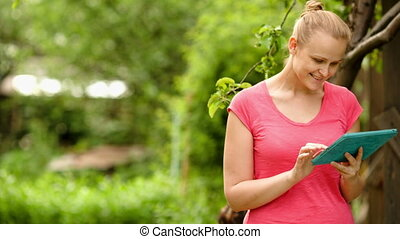 Woman working with tablet PC outdoor
