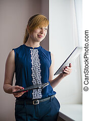 woman working with the device 2 in 1 ultrabook