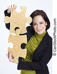 Woman Working With Two Large Jigsaw Puzzle Pieces
