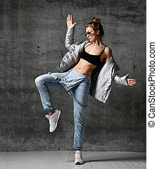 Woman workout exercise stand in silver sexy down puffer...