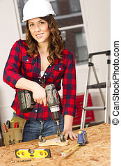 Woman Works on a Bench Repairing A Dolly - A Female works on...