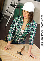 Woman Works on Construction Project Plywood Hardhat Tools Hammer