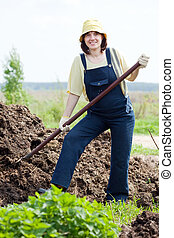 Woman works with animal manure - Woman works with animal...