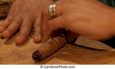 Woman works with Cigar