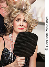 Woman Worried About Hairdo - Worried lady holding mirror ...