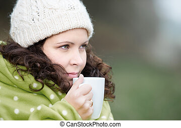 Woman Wrapped In Scarf Drinking Coffee - Closeup of young...