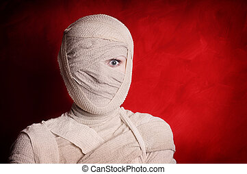 mummy halloween costume - woman wrapped up with bandages as...