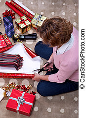 Woman wrapping a scarf for Christmas.