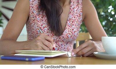 Woman write in diary