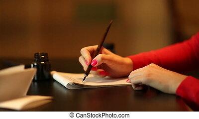 Woman write something. Home scene