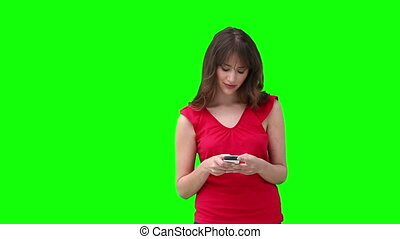Woman writing a text message before looking to her side