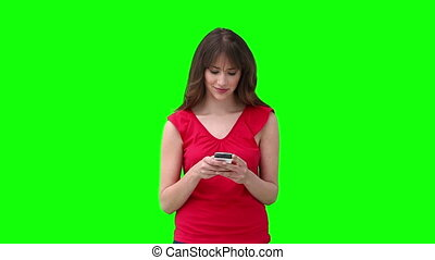 Woman writing a text message before looking at the camera