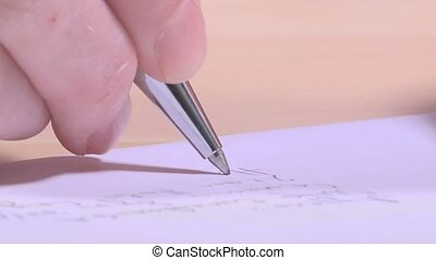 Woman writing address on envelope, extreme close up macro...