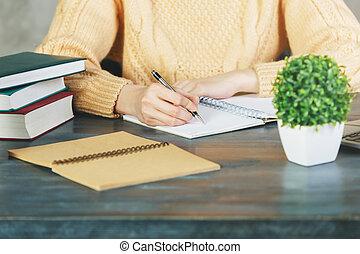 Woman writing in copybook